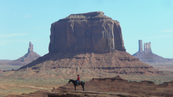 A cowboy in Monument Valley